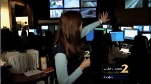 Screen Capture of a WSB-TV reporting broadcasting from the TMC