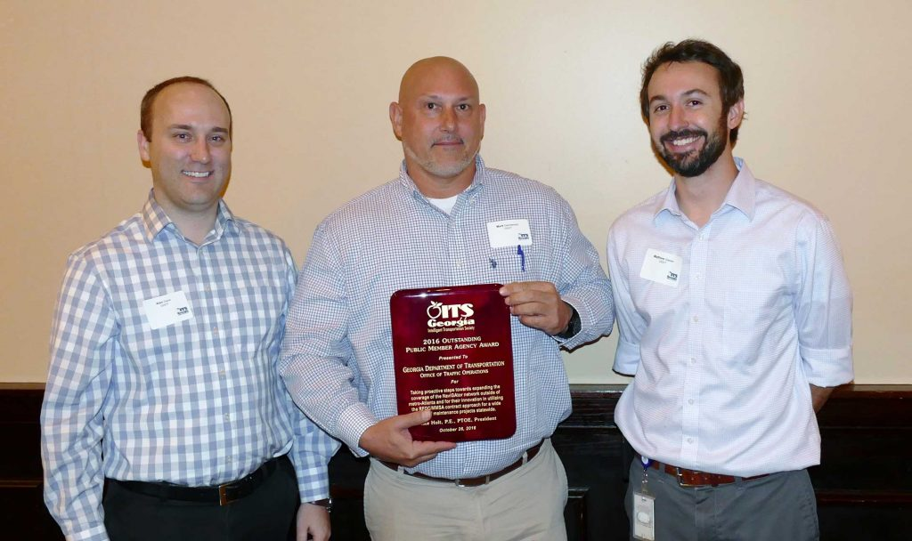 Mark Demidovich (C), presents the 2016 ITS Georgia Best of ITS Outstanding Public Member award to Alan Davis (L) and Matt Glasser of the Georgia Department of Transportation