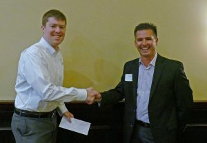 William Woolery (L), receives a check for being awarded an ITS Georgia 2016 Wayne Shackelford Scholarship from Keary Lord